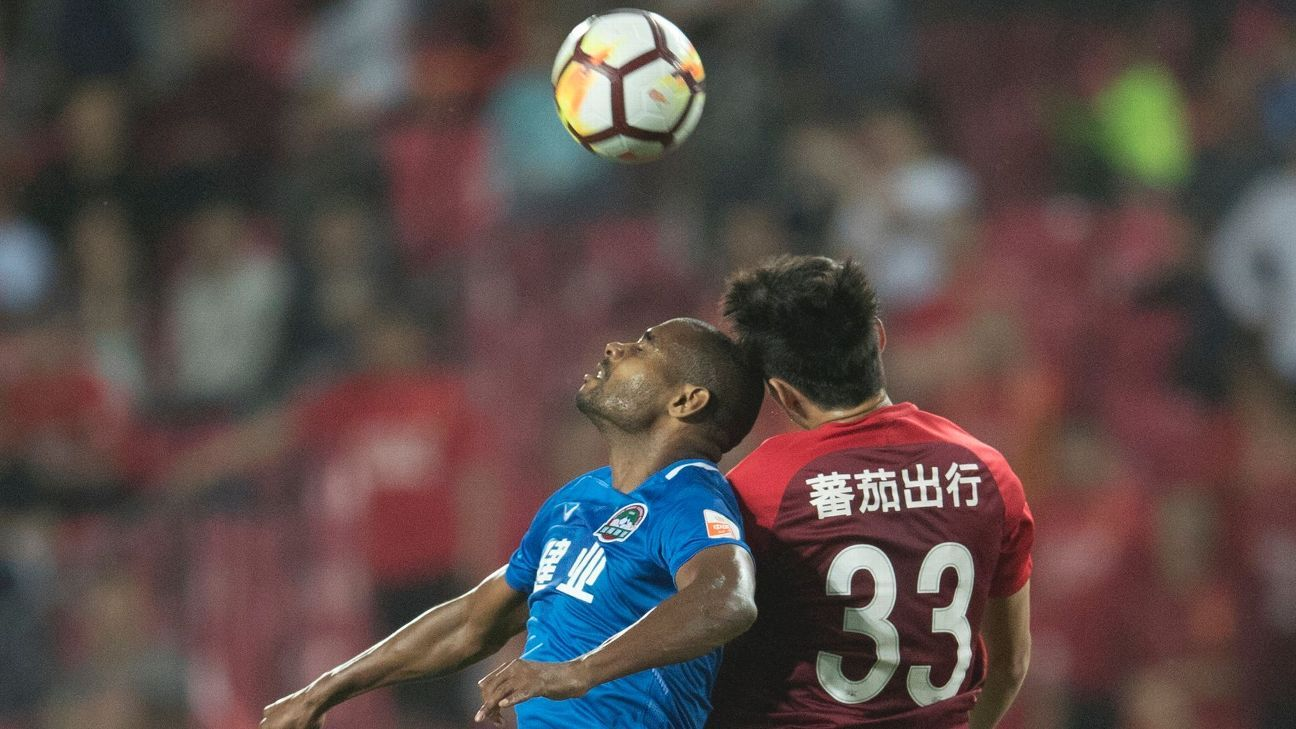 Henan Jianye's Ricardo Vaz Te battles for the ball with Hebei China Fortune's Zhunyi Gao
