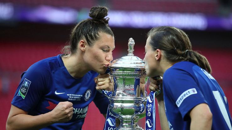 Chelsea Ladies' Ramona Bachmann, left, and Fran Kirby kiss the trophy after beating Arsenal in the Women's FA Cup final.