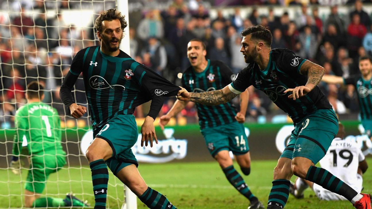 Manolo Gabbiadini celebrates scoring during Southampton's Premier League match at Swansea.