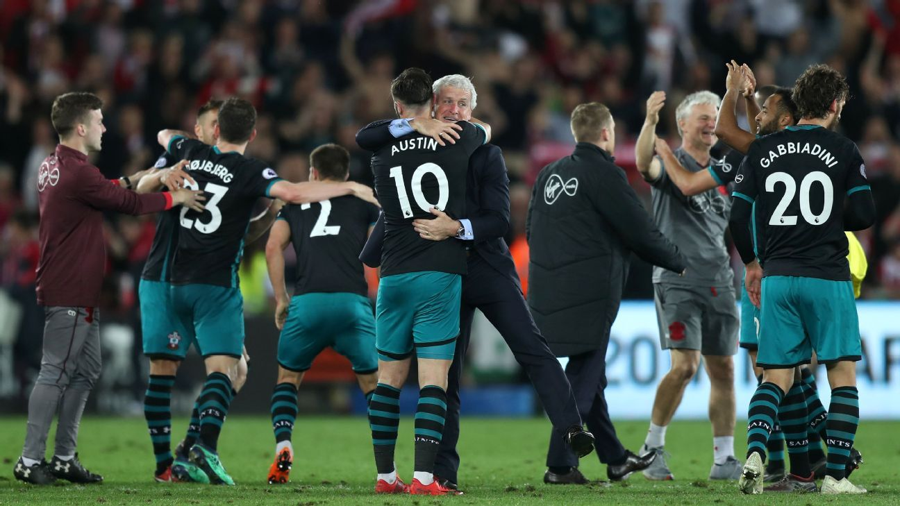 Southampton manager Mark Hughes (centre) celebrates with Charlie Austin after the final whistle.