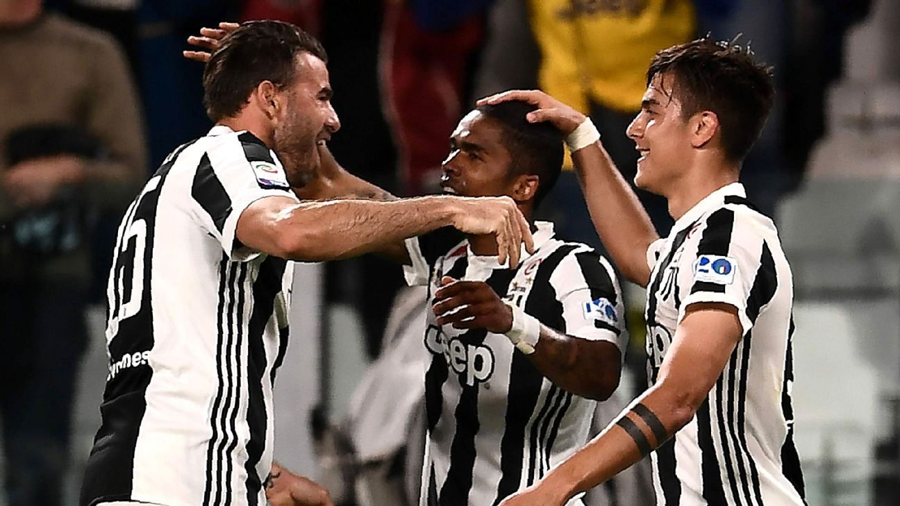 Andrea Barzagli (left) and Douglas Costa (center) are two players who regularly push Juventus to press on.