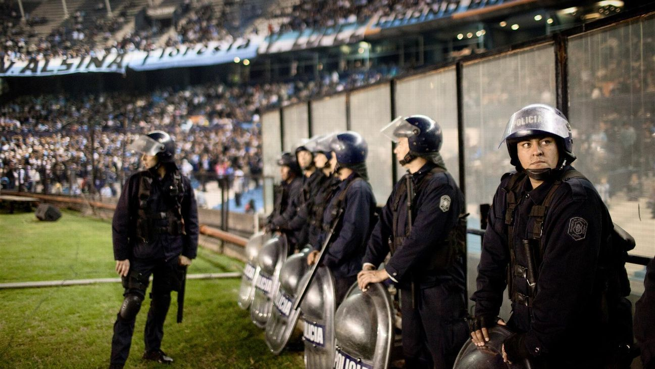 Argentinian Police officers are seen at the football match between Racing and Boca Juniors