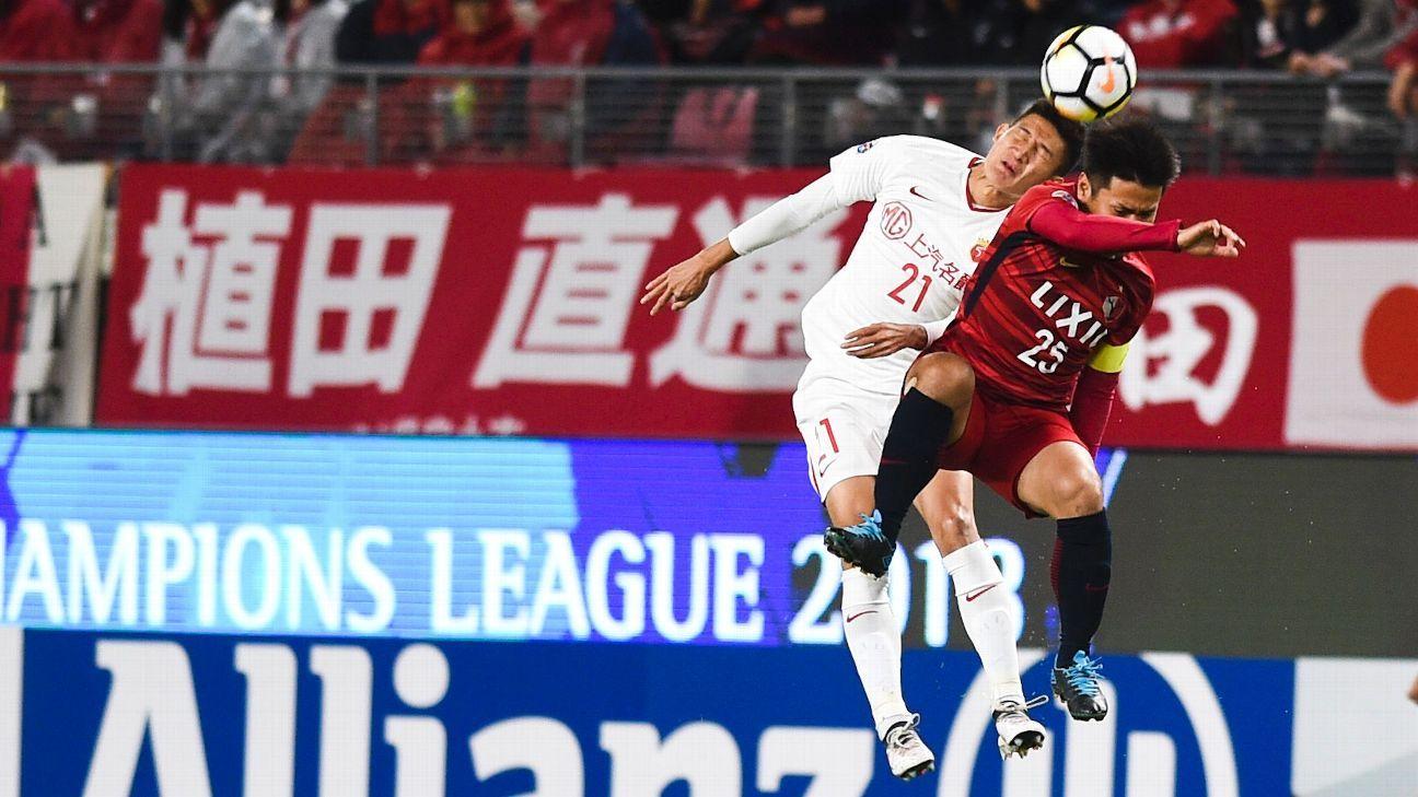 Shanghai SIPG's Yu Hai, left, and Kashima Antlers' Yasushi Endo
