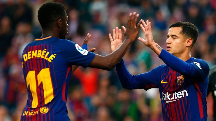 Ousmane Dembele and Philippe Coutinho celebrate during Barcelona's win over Villarreal.