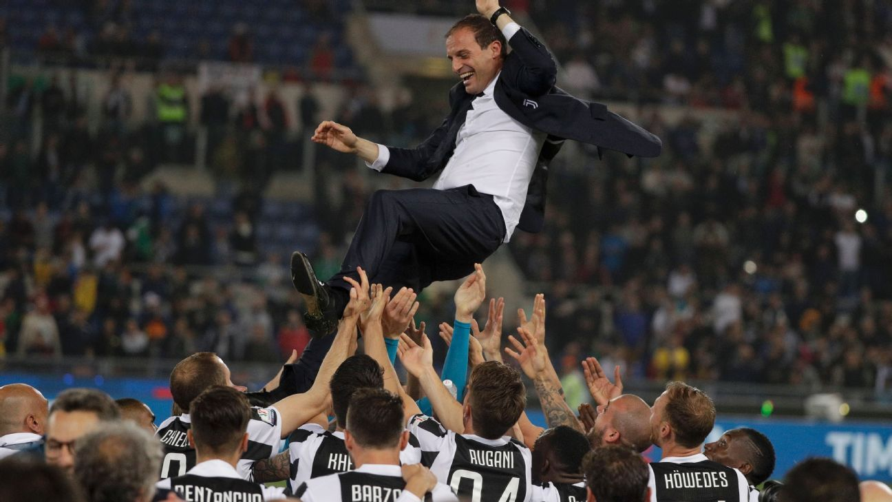 Massimiliano Allegri is raised aloft by the players after Juventus beat AC Milan in the Coppa Italia final.