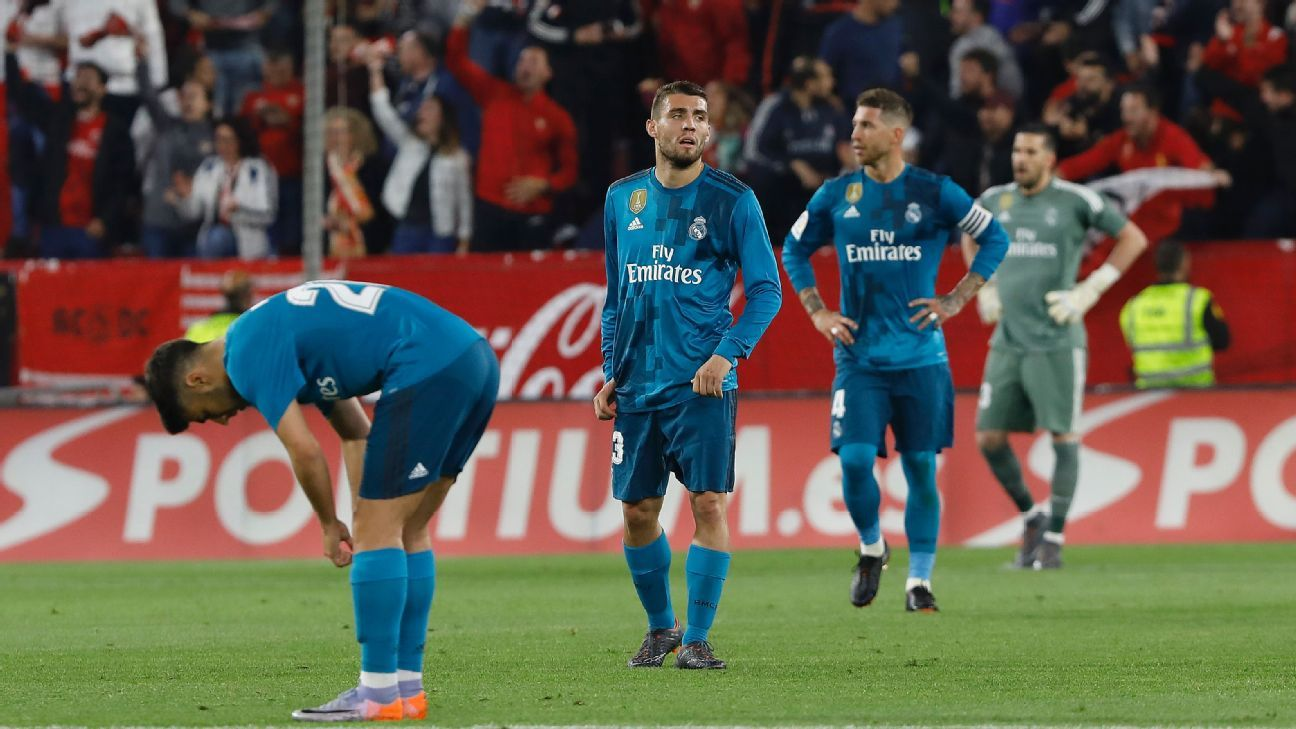 Real Madrid players react after conceding a goal to Sevilla in La Liga.