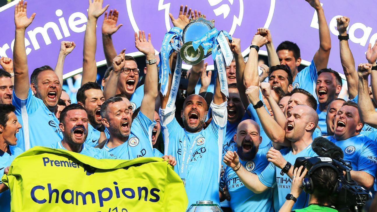 Pep Guardiola lifts the Premier League trophy as Manchester City ended 2017-18 with 100 points.