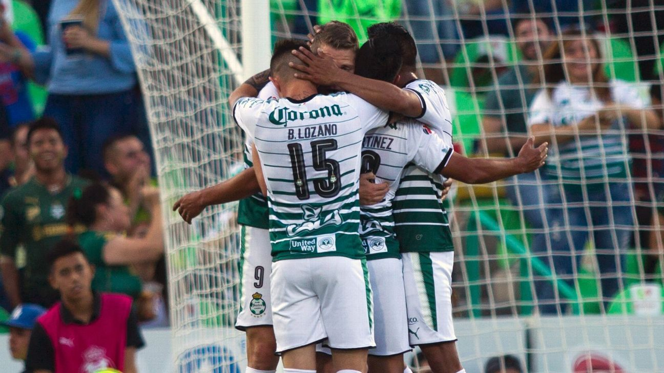 Santos players celebrate after scoring against America during its Clausura semifinal first leg win.