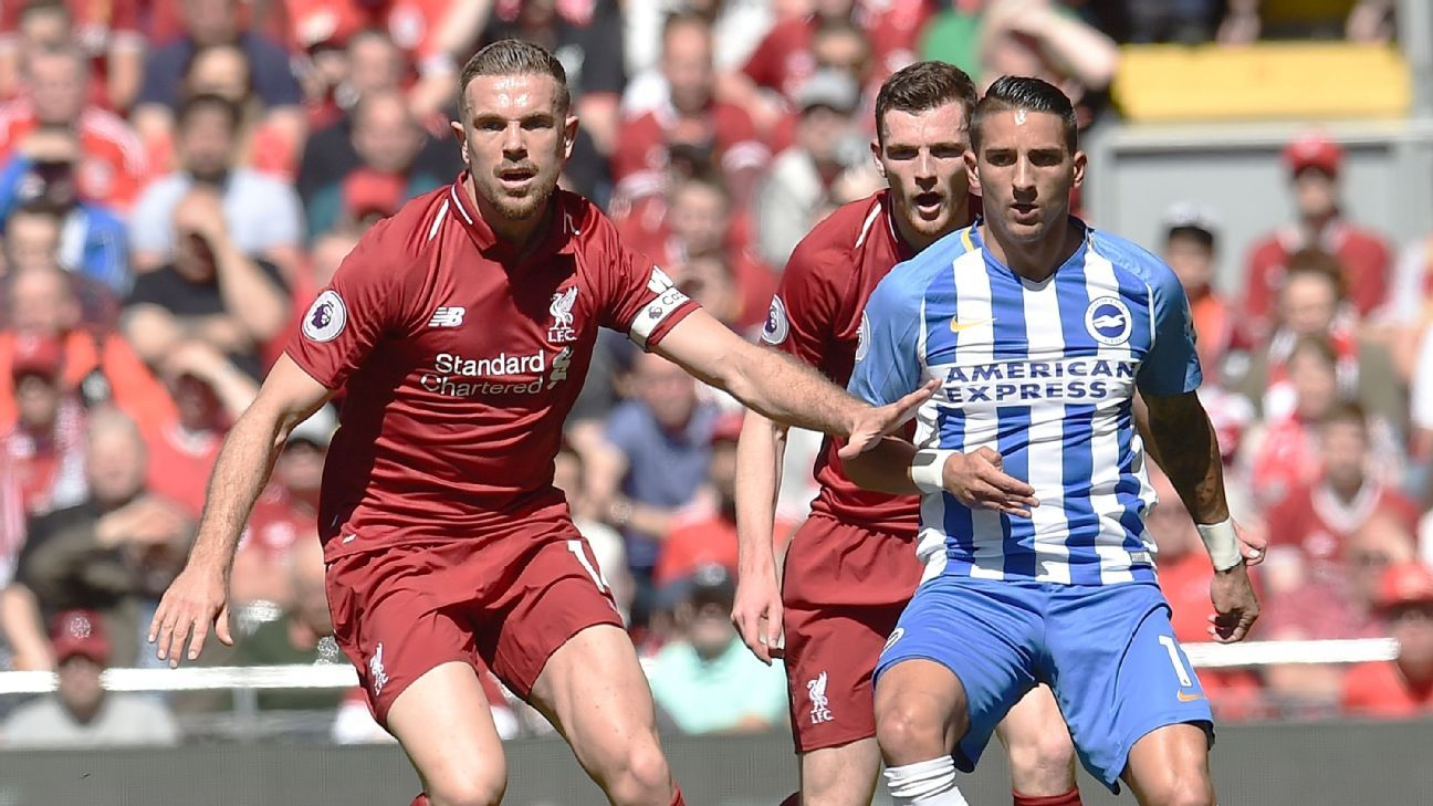 Jordan Henderson of Liverpool  with Anthony Knockaert of Brighton Hove Albion
