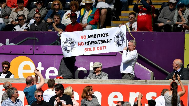 Swansea fans hold up a sign reading 'No Ambition No Investment Sold Out!'