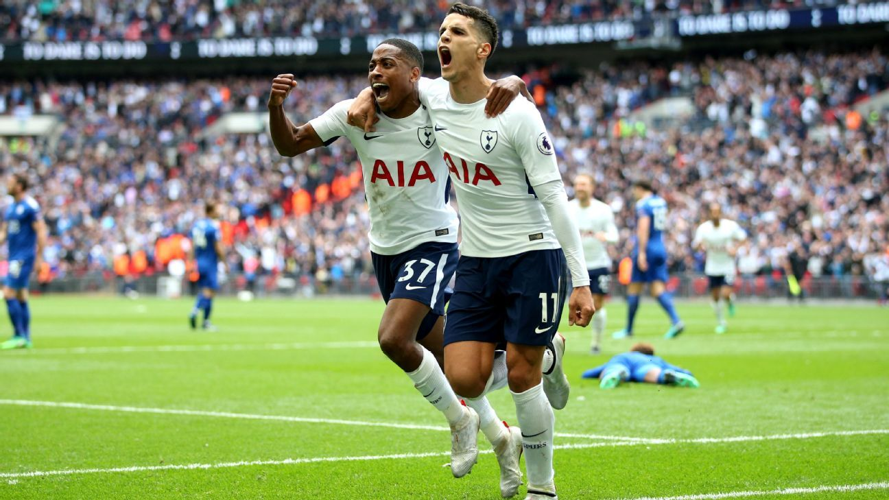 Erik Lamela celebrates with Kyle Walker-Peters during Tottenham's 5-4 win over Leicester.