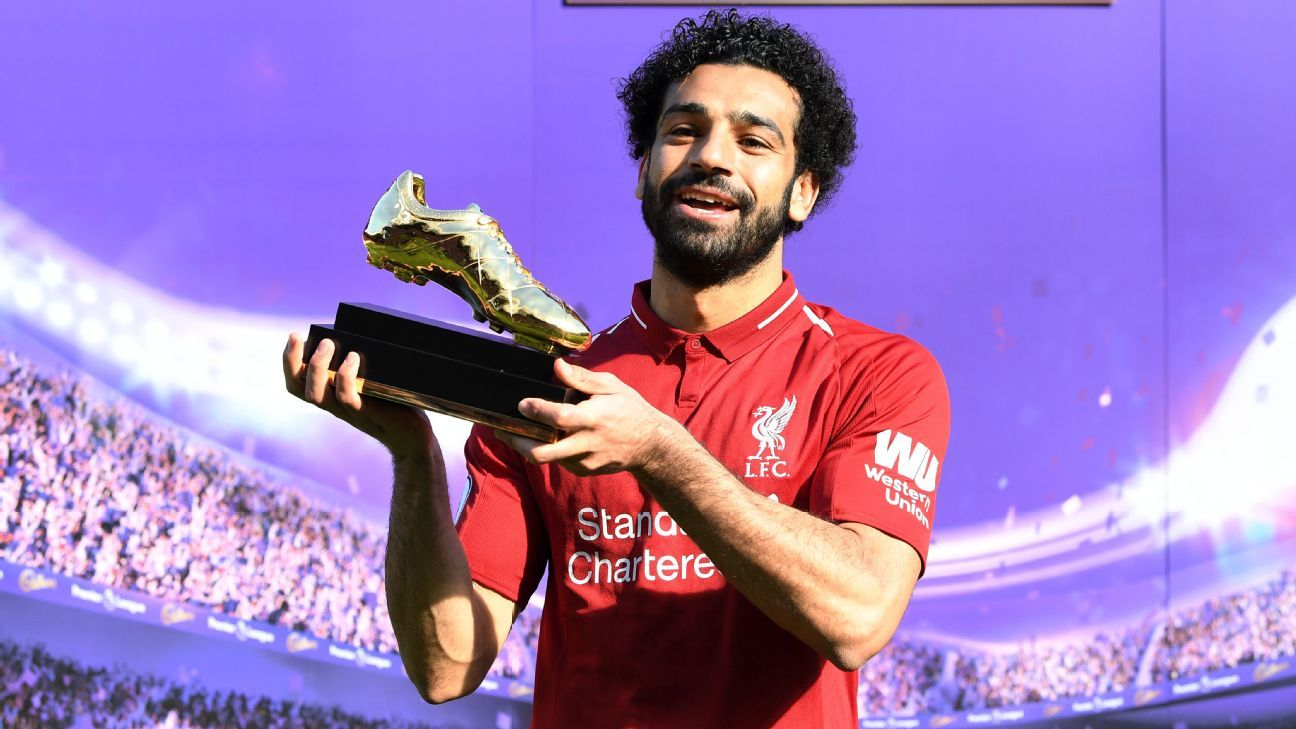 Mohamed Salah of Liverpool pose for a photo with his Premier League Golden Boot award.