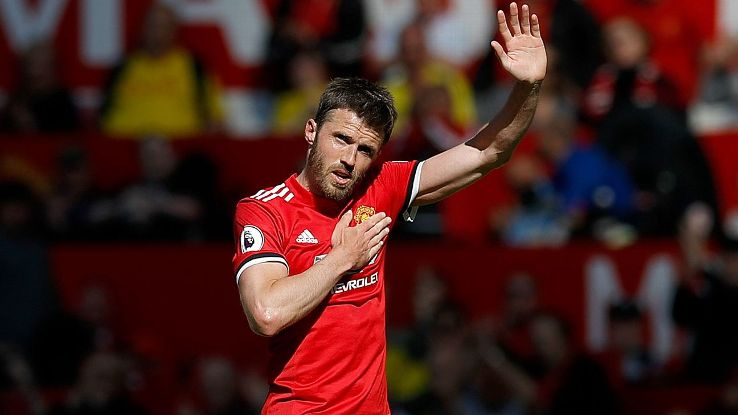Manchester United's Michael Carrick salutes the fans as he leaves the field.