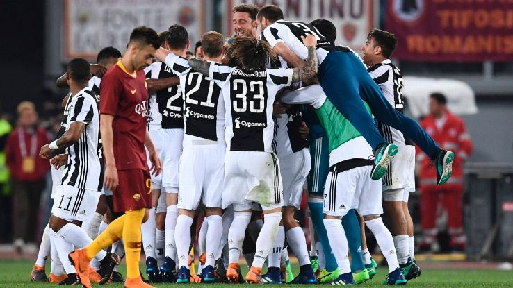 Juventus players celebrate after a 0-0 draw with Roma that secured the Serie A title for a seventh-straight season.