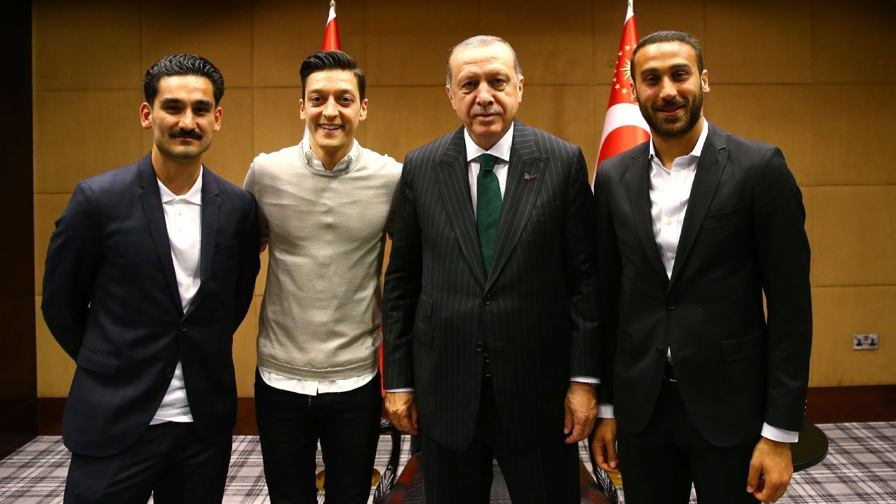 Ilkay Gundogan, left, with Mesut Ozil, Turkey President Recep Tayyip Erdogan and Cenk Tosun.