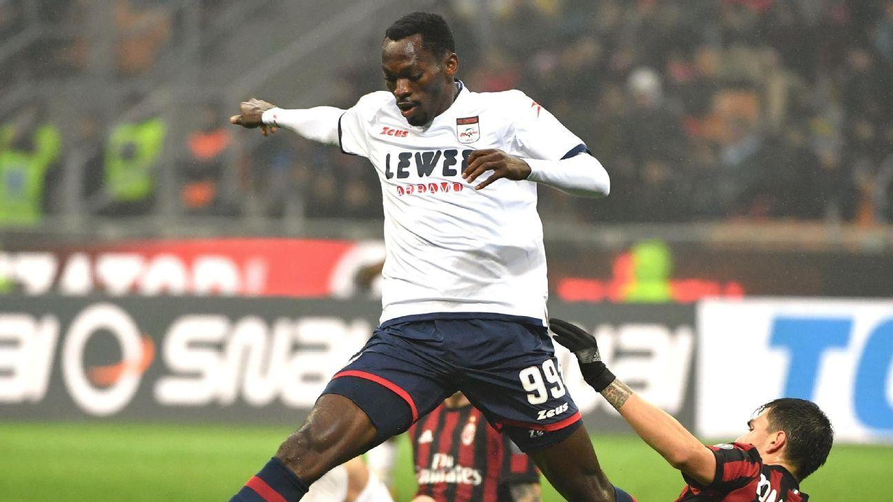 FC Crotones forward Simeon Tochukwu Nwankwo is challenged by AC Milan defender Alessio Romagnol