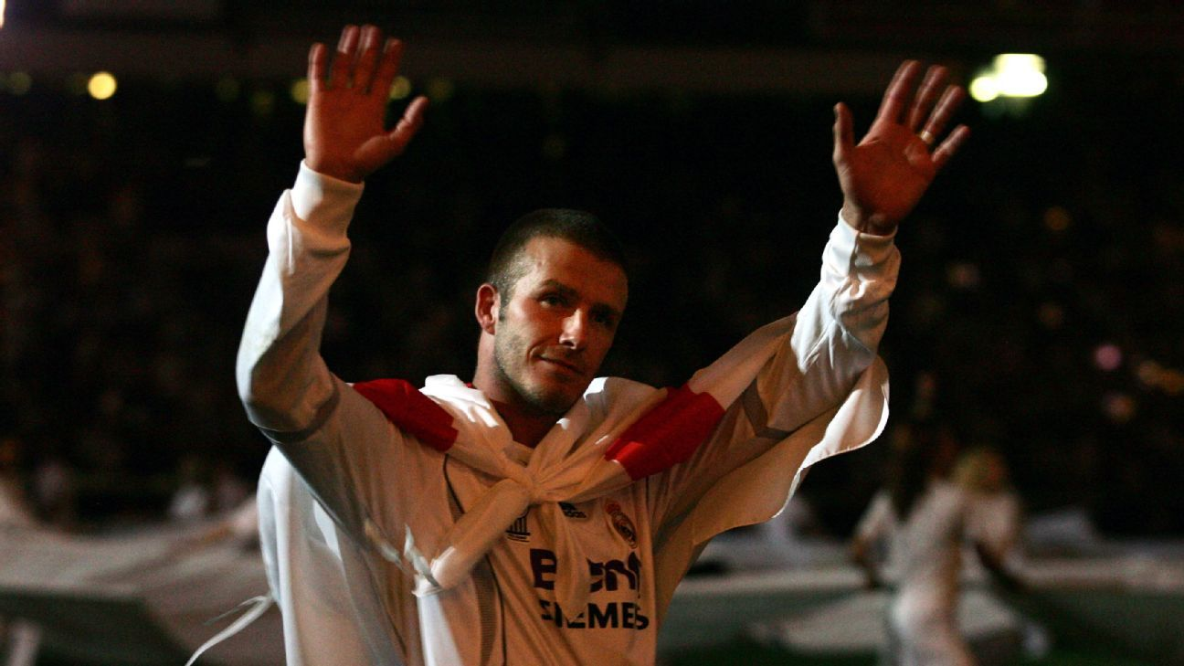 David Beckham celebrates after Real Madrid secured the Liga title.