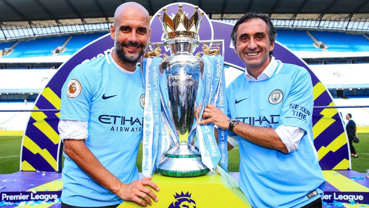 Pep Guardiola and Manel Estiarte with the Premier League trophy.