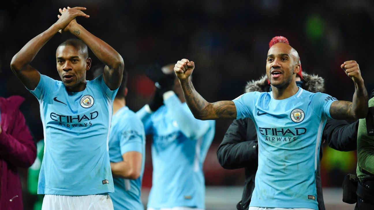 Fernandino, left, and Fabian Delph celebrate Manchester City's win over Manchester United.