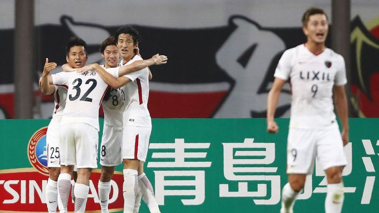 Kashima Antlers celebrate after scoring a goal against Shanghai SIPG in the Asian Champions League.
