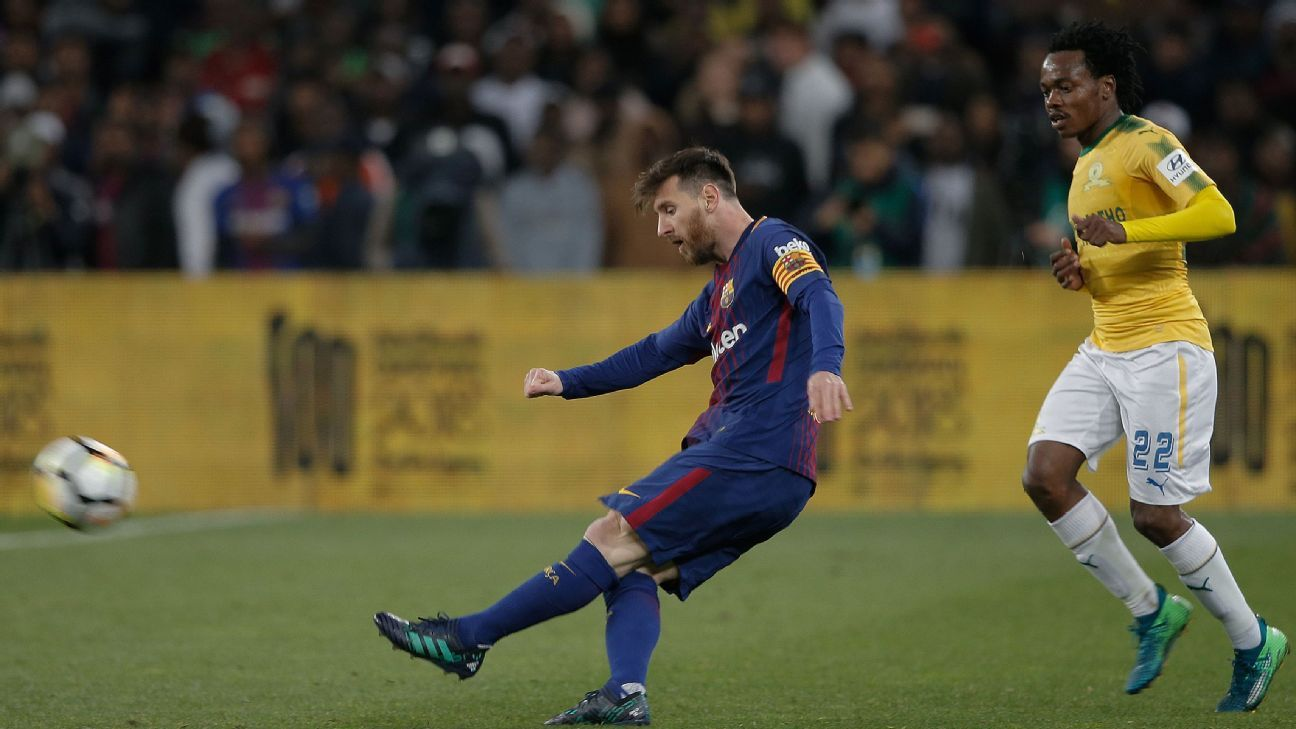 Barcelona's Lionel Messi clears the ball during their friendly match at Mamelodi Sundowns.