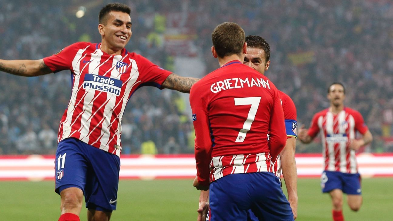 Atletico's Antoine Griezmann celebrates with teammates after scoring.