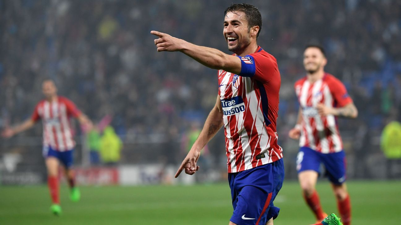 Atletico Madrid's Spanish midfielder Gabi celebrates after scoring in the Europa League final.