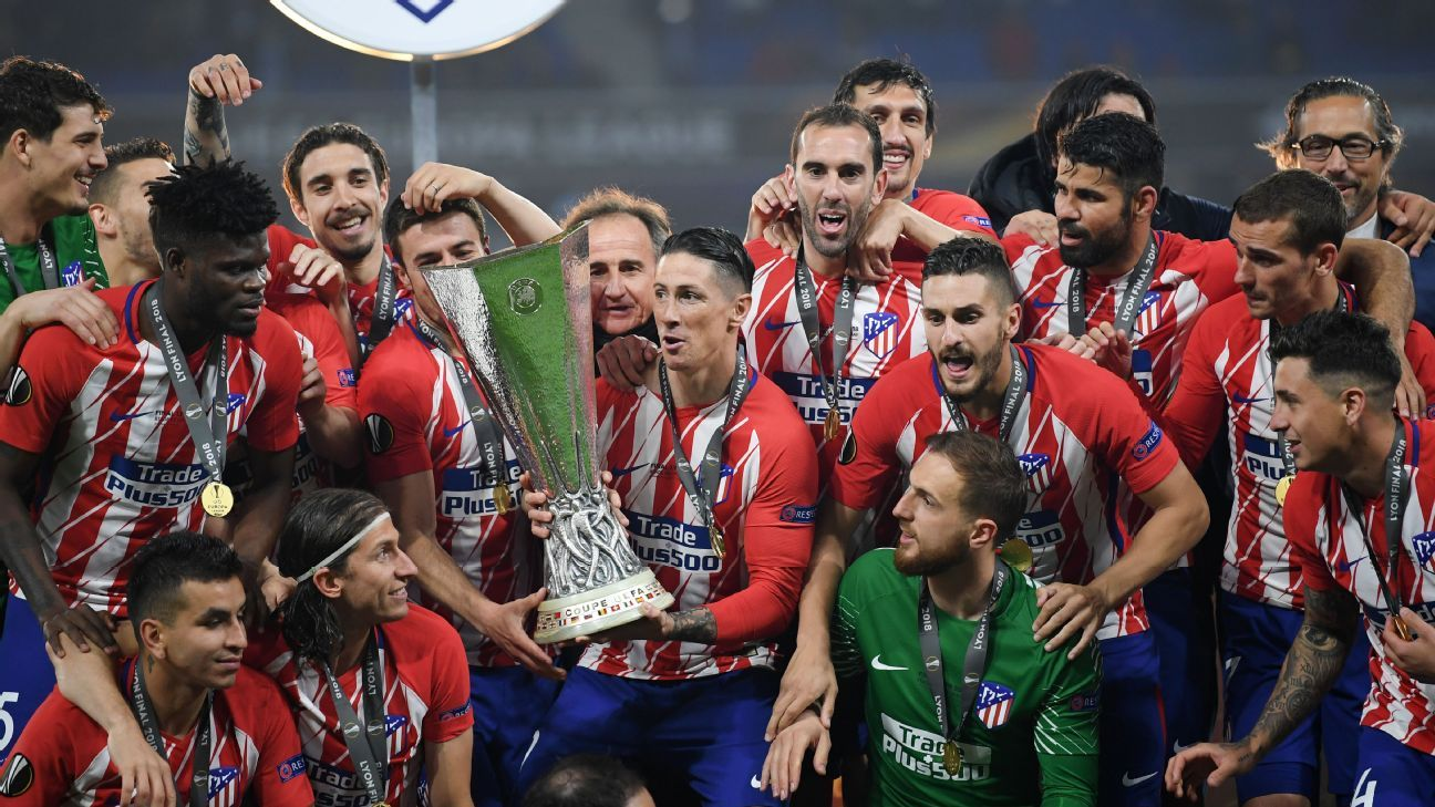 Atletico Madrid players lift the Europa League trophy.