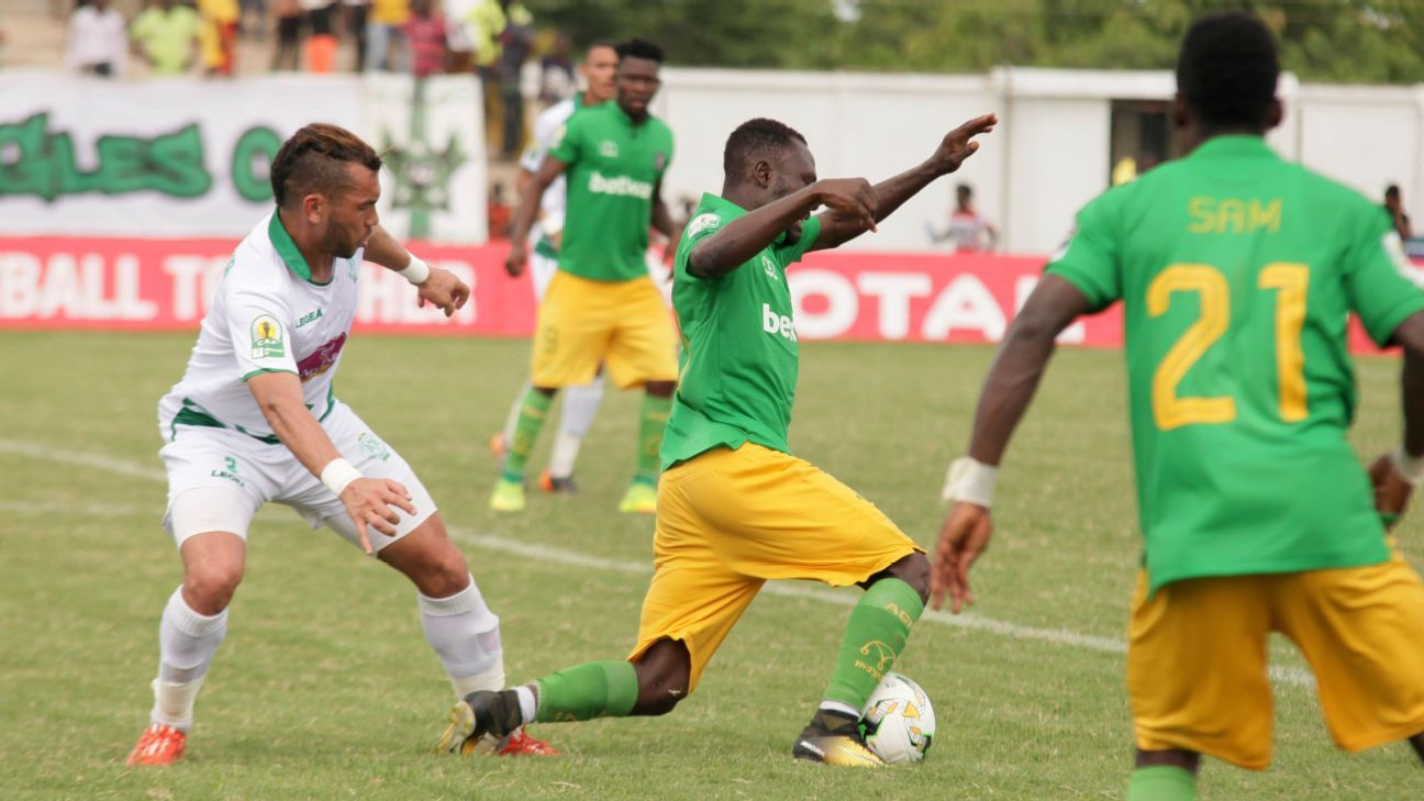 Badr Benoun of Raja Club Athletic and Bright Adjei of Aduana Stars FC