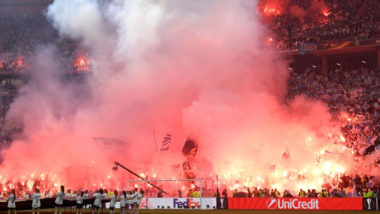 Fans let off flares ahead of the Europa League final between Marseille and Atletico Madrid.