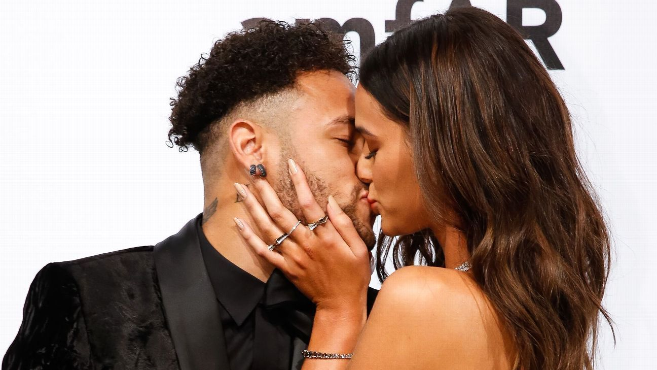Neymar and Bruna Marquezine share a kiss at the the 2018 amfAR Gala in Sao Paulo