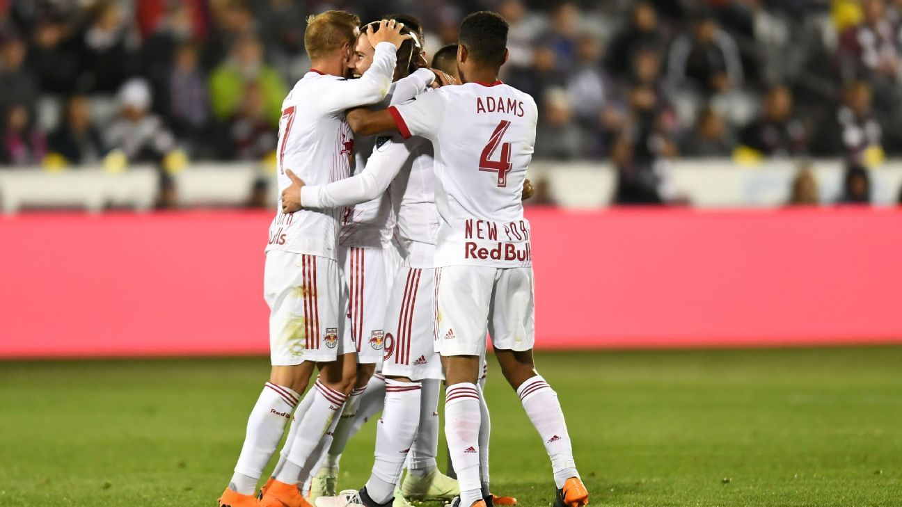 Tyler Adams, right, and the New York Red Bulls celebrate during an MLS match at the Colorado Rapids.