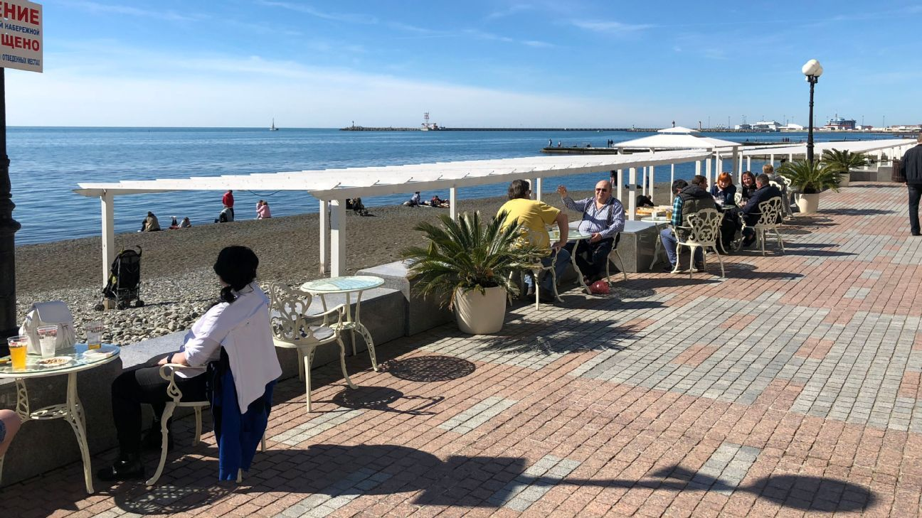 Russians enjoy the local sun and sand of Sochi, a neat reminder of what the city was founded upon before more cosmopolitan and international concerns came to town.