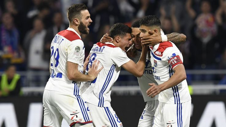 Lyon players celebrate with Memphis Depay after he scored one of his three goals in a win against Nice.