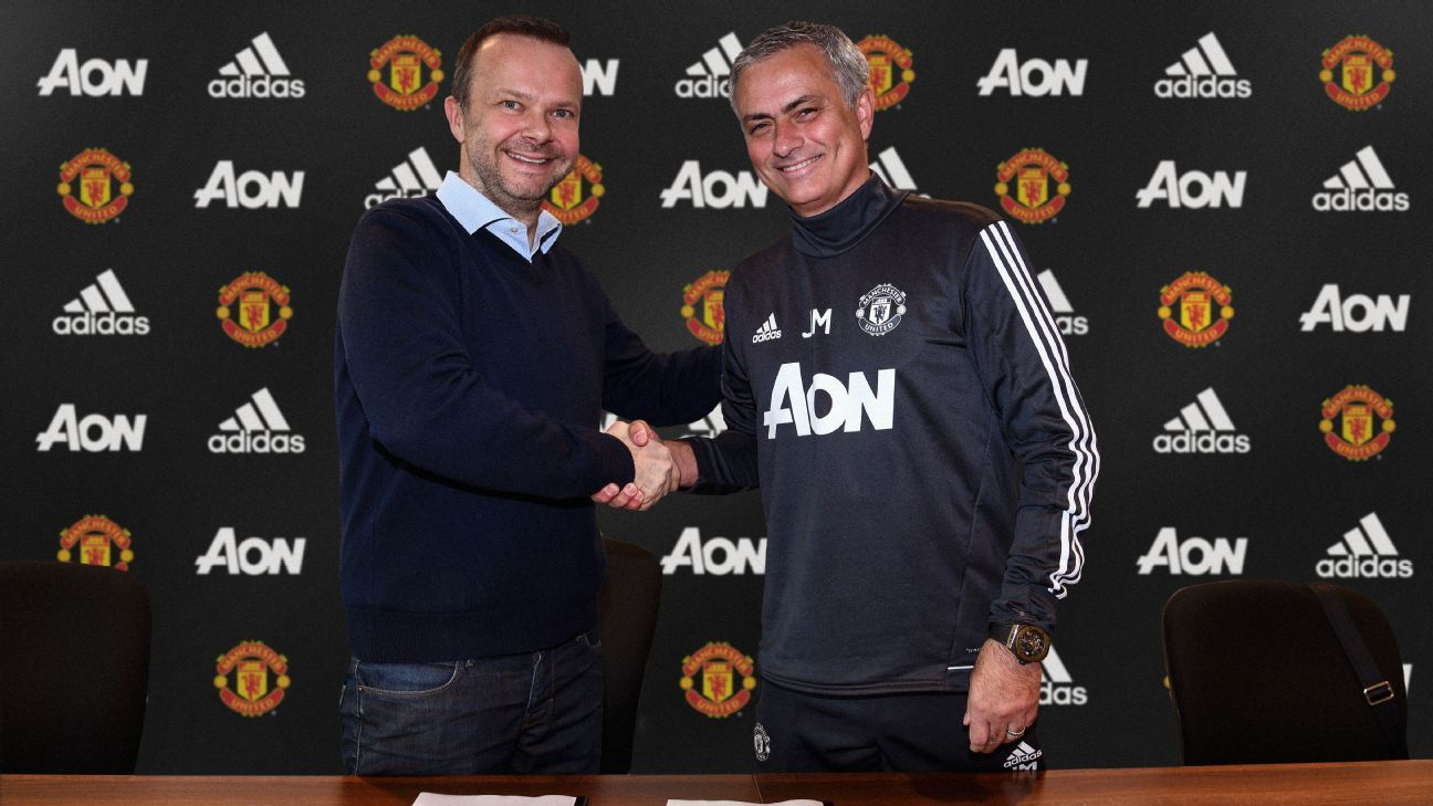 Manchester United executive vice-chairman Ed Woodward and manager Jose Mourinho shake hands after the latter's contract extension.