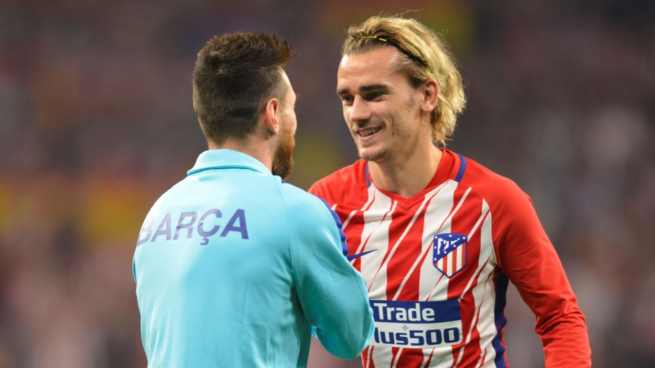 Barcelona's Lionel Messi, left, and Atletico Madrid's Antonie Griezmann