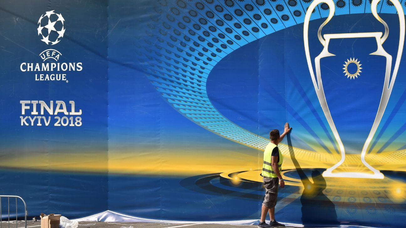 A worker sets decoration in the fan zone of the 2018 UEFA Champions League Final in Kiev.