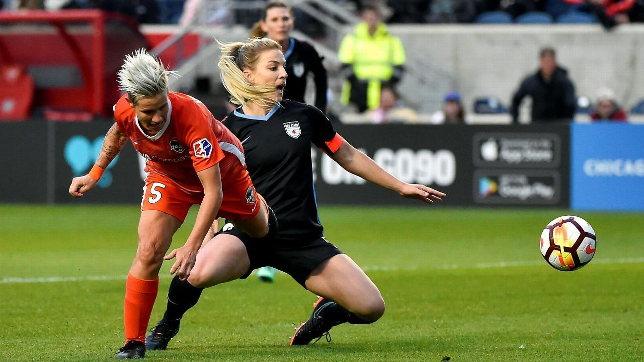 Houston Dash's Janine van Wyk goes against Chicago Red Stars and USA midfielder Julie Ertz.