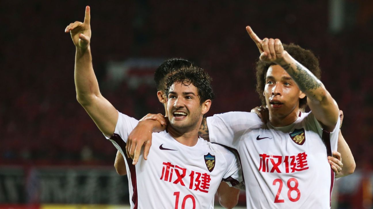 Tianjin Quanjian's Alexandre Pato, left, and Axel Witsel.