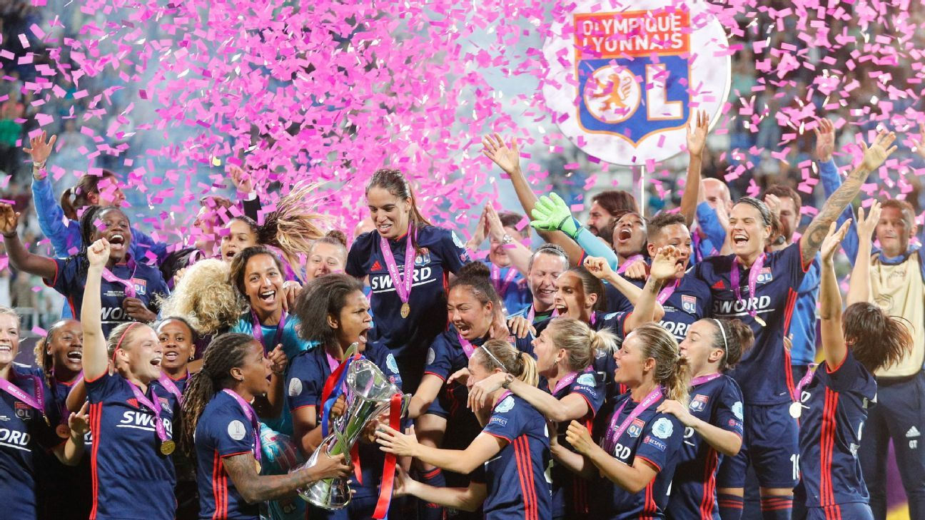 Lyon players celebrate with the trophy after winning the UEFA Women's Champions League.