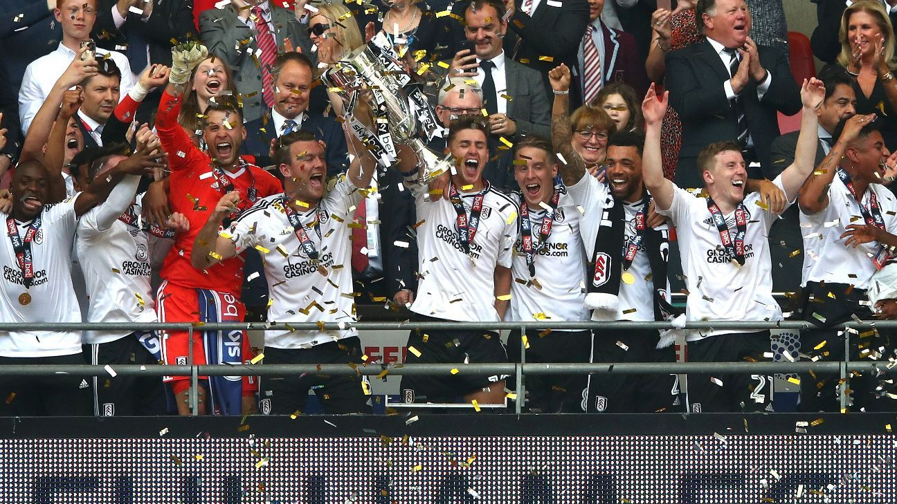 Fulham celebrate promotion to the Premier League after beating Aston Villa 1-0 at Wembley.