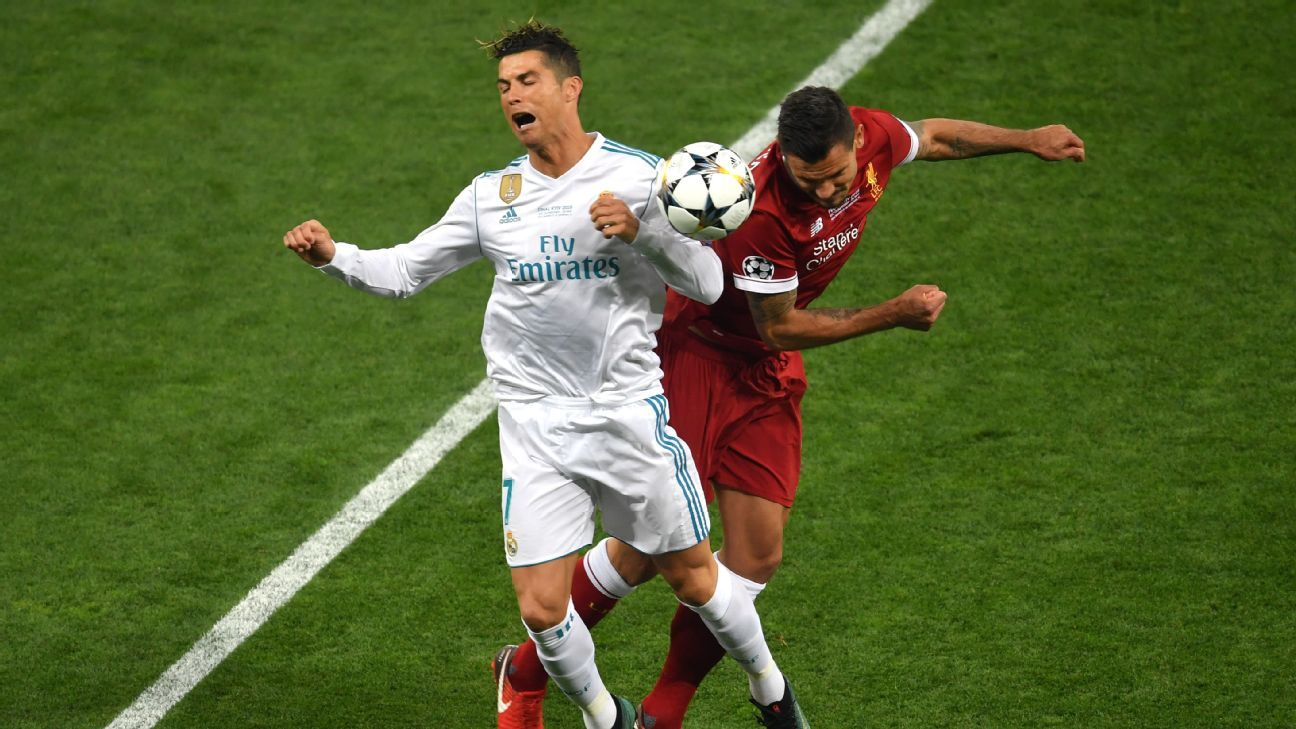 Real Madrid's Cristiano Ronaldo and Liverpool's Dejan Lovren vie for the ball in the Champions League final.