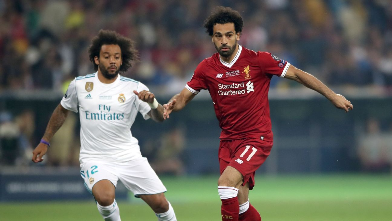 Mohamed Salah and Marcelo fight for possession during the Champions League final.