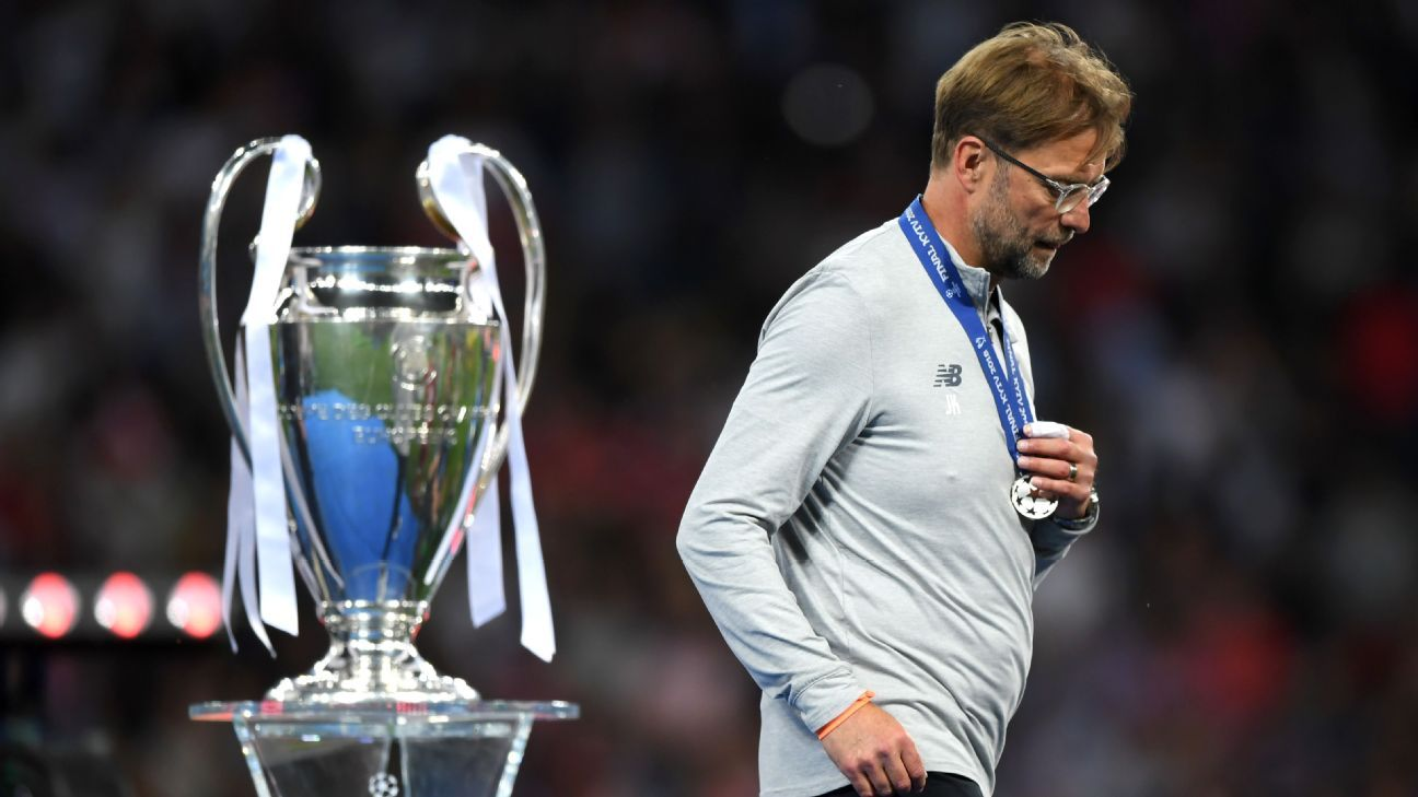 Jurgen Klopp walks past the Champions League trophy following Liverpool's 3-1 defeat against Real Madrid.