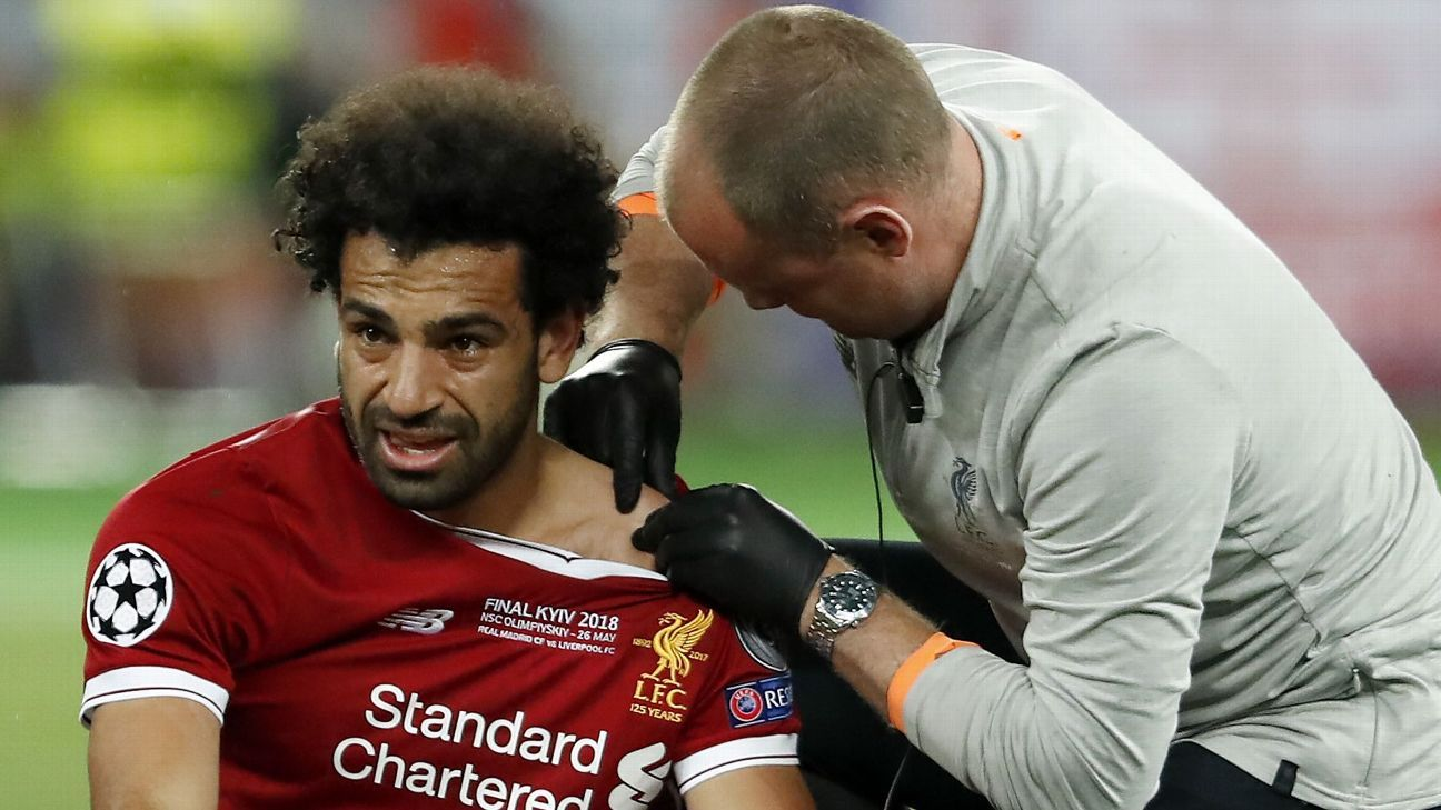 Mohamed Salah has his shoulder injury treated during Liverpool's Champions League final defeat against Real Madrid.