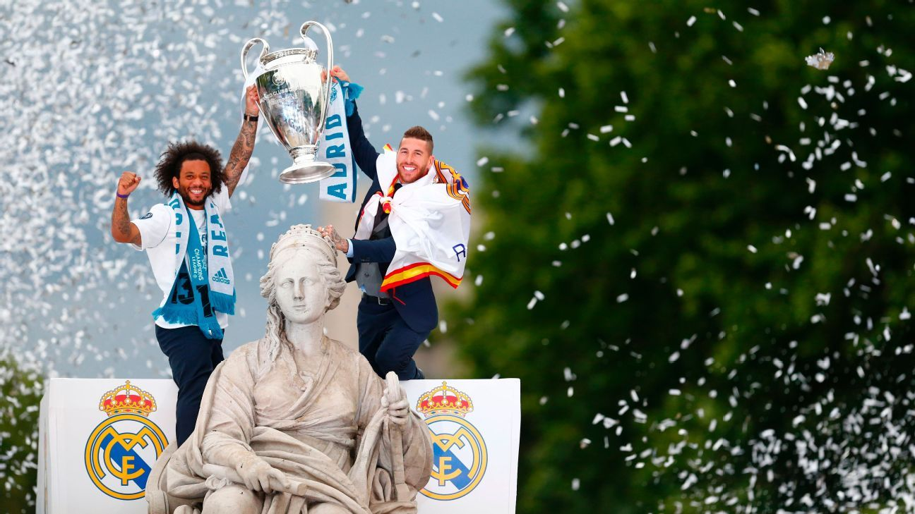 Marcelo and Sergio Ramos hold the Champions League trophy during Real Madrid's title celebrations.
