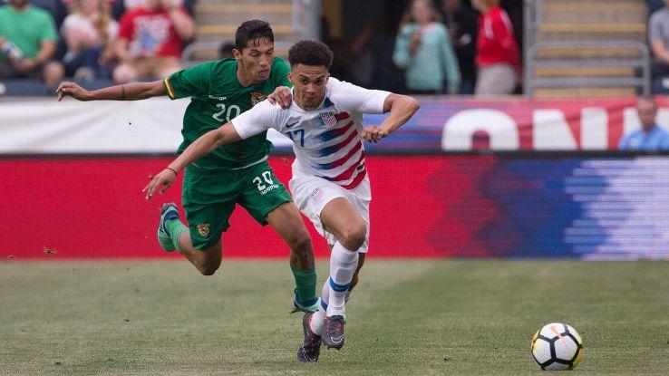 Antonee Robinson, right, vies for the ball in the U.S.'s 3-0 friendly win over Bolivia.