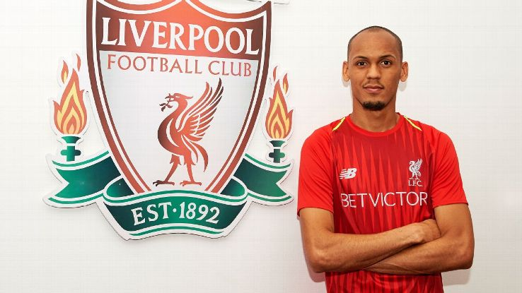 Fabinho poses for a photo after signing for Liverpool.