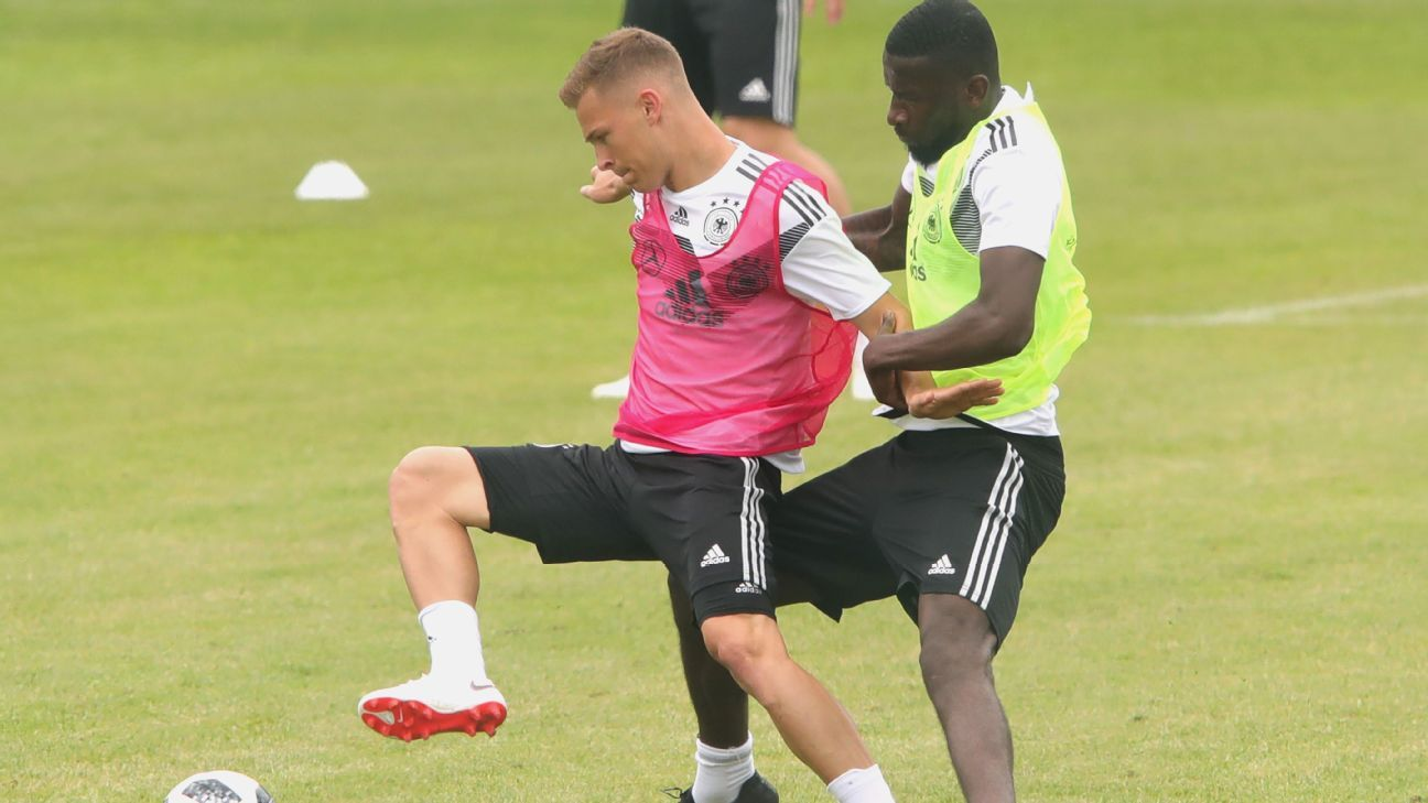 Joshua Kimmich and Antonio Rudiger battle for the ball in training.