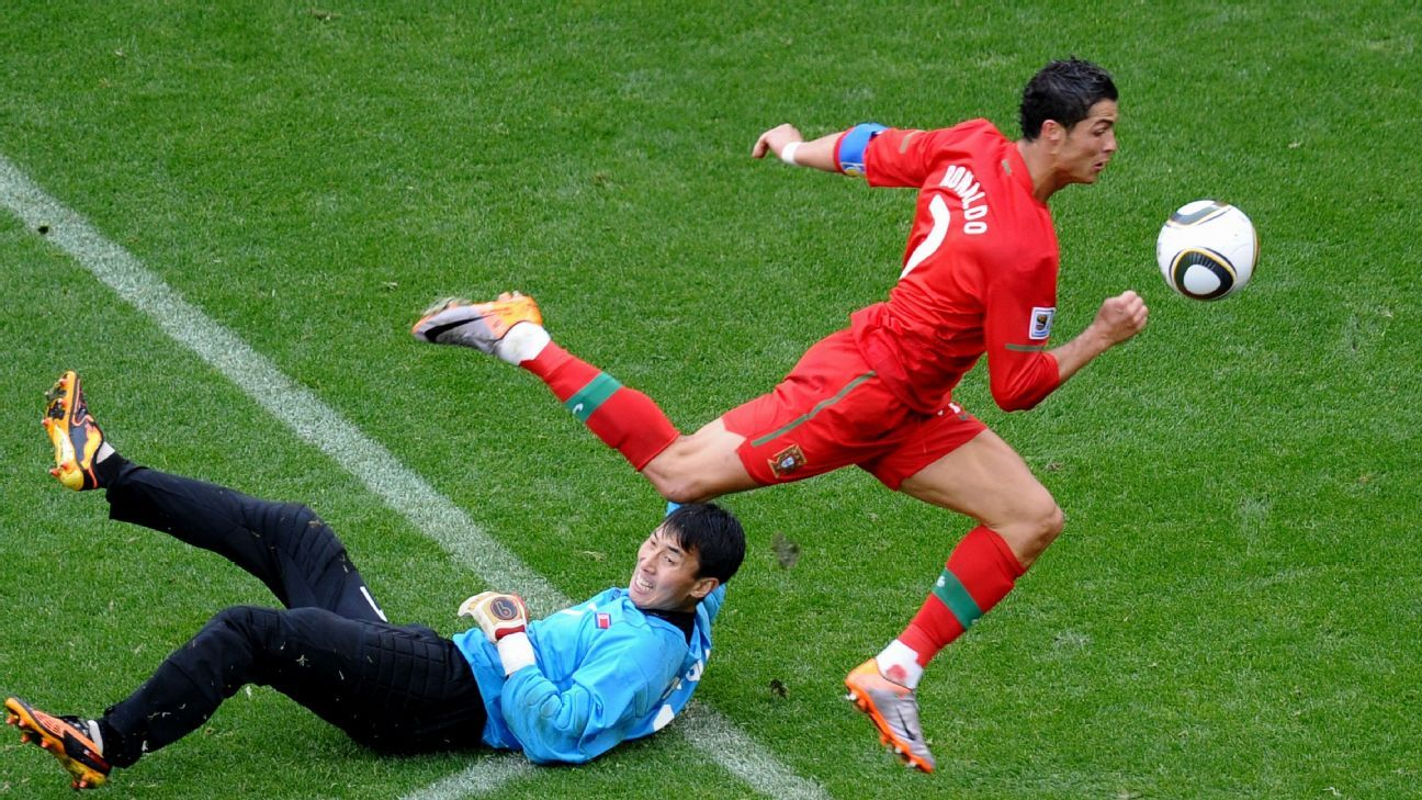 Ronaldo jumps over North Korea's goalkeeper Ri Myong-Guk before scoring Portugal's sixth.